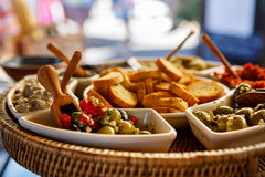 Different olive tapenades on provencal street. Different tapenade of black and green olives with garlic bread on provencal street market in Provence, France stock images