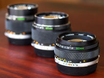 Different OM lenses composed together in natural light Stock Photography