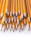The different one. Pile of yellow pencils and one gray Stock Photo
