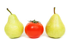 Different one. Red tomato and two pears Royalty Free Stock Images