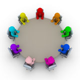 Different opinions at the meeting. Different colored businessmen are sitting around a table Royalty Free Stock Images