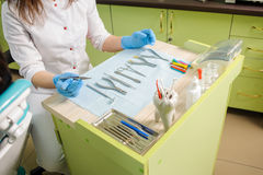Different orthodontic instruments and tools in a dentist& x27;s office. Stock Photo