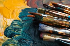 Different paint brushes on canvas, closeup. stock photo