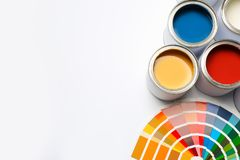 Different paint cans and color palette on white background, top view. Space for text stock photo