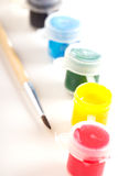 Different paint in small plastic jars Royalty Free Stock Photography
