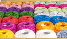 Different colored bag of wool stock photos