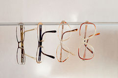 Different pairs of eyeglasses Stock Photos