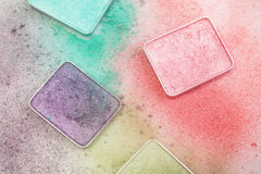 Different palletes for make-up. Different palettes for make-up with crumbs around on white Stock Photography
