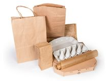 Different paper and carton food packaging on a white background. Different brown paper food packaging bags, carton box, egg box and other recyclable packing for stock image