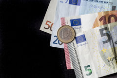 Different paper euro currency on a black background Stock Photos