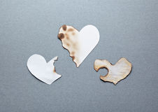 Different paper hearts. Partially damaged Royalty Free Stock Photo