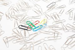 Different paperclips on white Stock Photography