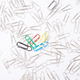 Different paperclips on white Royalty Free Stock Images
