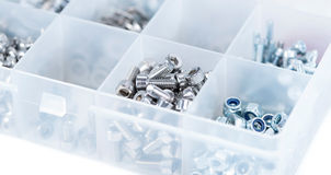 Different Parts sorted in a box. Different Screws and other Parts sorted in a box (close-up shot royalty free stock photos