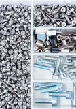 Different Parts sorted in a box. Different Screws and other Parts sorted in a box (close-up shot Royalty Free Stock Photo