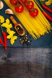 Different pasta on a dark  background. Stock Images