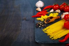 Different pasta on a dark  background. Stock Photography