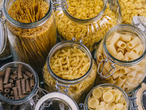 Different pasta in large glass jars. Photo of different pasta types in large glass jars Royalty Free Stock Photos