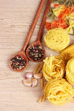 Different pasta and spices Stock Photos