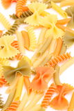 A different pasta in three colors close-up. Stock Photos