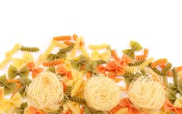 Different pasta in three colors. Stock Photos