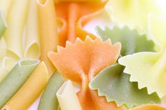 Different pasta in three colors. Macro. Stock Image