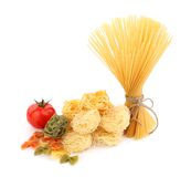 Different pasta and tomato Royalty Free Stock Photography