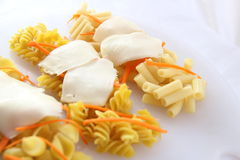 Different pasta on a white plate Stock Photos
