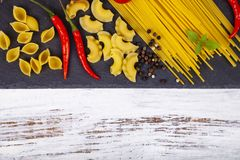Different pasta on a  wooden background Royalty Free Stock Photography