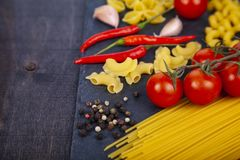 Different pasta on a  wooden background Royalty Free Stock Photos