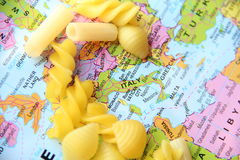 Different pasta on world map Stock Photography