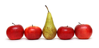 Different - pear between green apples Stock Photos