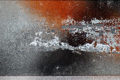 Different peeled and scratched dyes on rough metal surface Stock Image