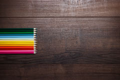 Different pencils over brown table background Stock Images