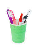 Different pens in a green plastic cup Stock Images