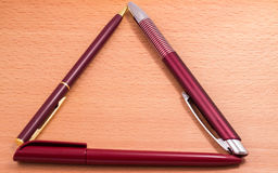 Different pens on a wooden background royalty free stock photos