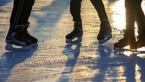 Different people are actively skating on an ice rink. hobbies and leisure. winter sports