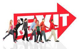 Different people go out following the exit sign Royalty Free Stock Photos