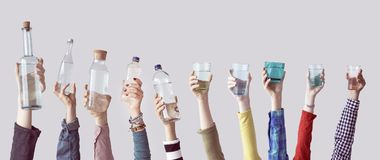Different people holding water bottles and glass Stock Images