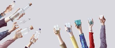 Different people holding water bottles and glass Stock Image
