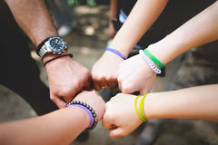 Different people put a hand in the center outdoor. In a sign of team spirit Royalty Free Stock Photography