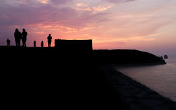 Different People Silhouettes at Sunset Stock Photography