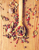 Different pepper seeds, cardamom and nutmeg Royalty Free Stock Photography