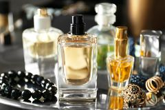 Different perfume bottles and accessories. On tray, closeup Stock Image
