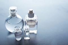 Different perfume bottles. On grey background Stock Photo