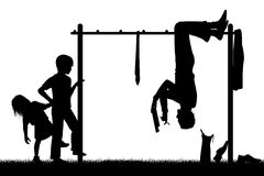 Different perspective. Editable vector silhouette of a man hanging upside down on a climbing frame to get a new perspective on his work with figures as separate Royalty Free Stock Photography