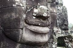 Stone faces in Cambodia stock photo