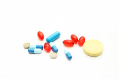 Different pharmacological preparations - tablets and pills. On a white background Stock Images