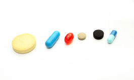Different pharmacological preparations - tablets and pills. On a white background Royalty Free Stock Photography