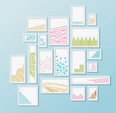 Different pictire frames with simple colorful geometric patters on bright blue wall. Set of realistic borders for art gallery mockup, wallpaper design, fully Stock Image